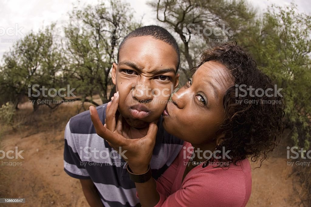 An African-American family making silly faces together stock photo