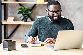 istock An African-American guy using laptop in the office 1254062265