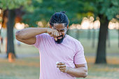 istock An African-American Man is Having Allergy Problems Outside in Nature. 1317994618