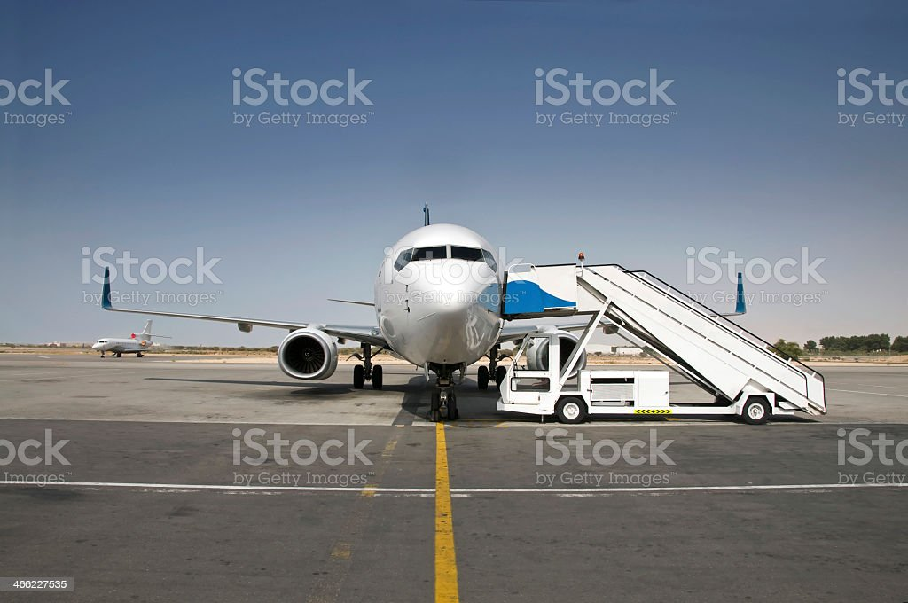 An aircraft being prepared for boarding stock photo