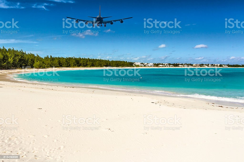 An Airplane approaching Exuma (Bahamas) over Emerald Bay stock photo