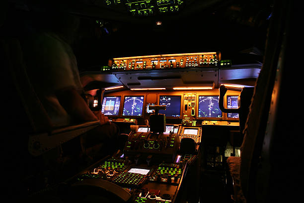 An airplane cockpit at night time stock photo