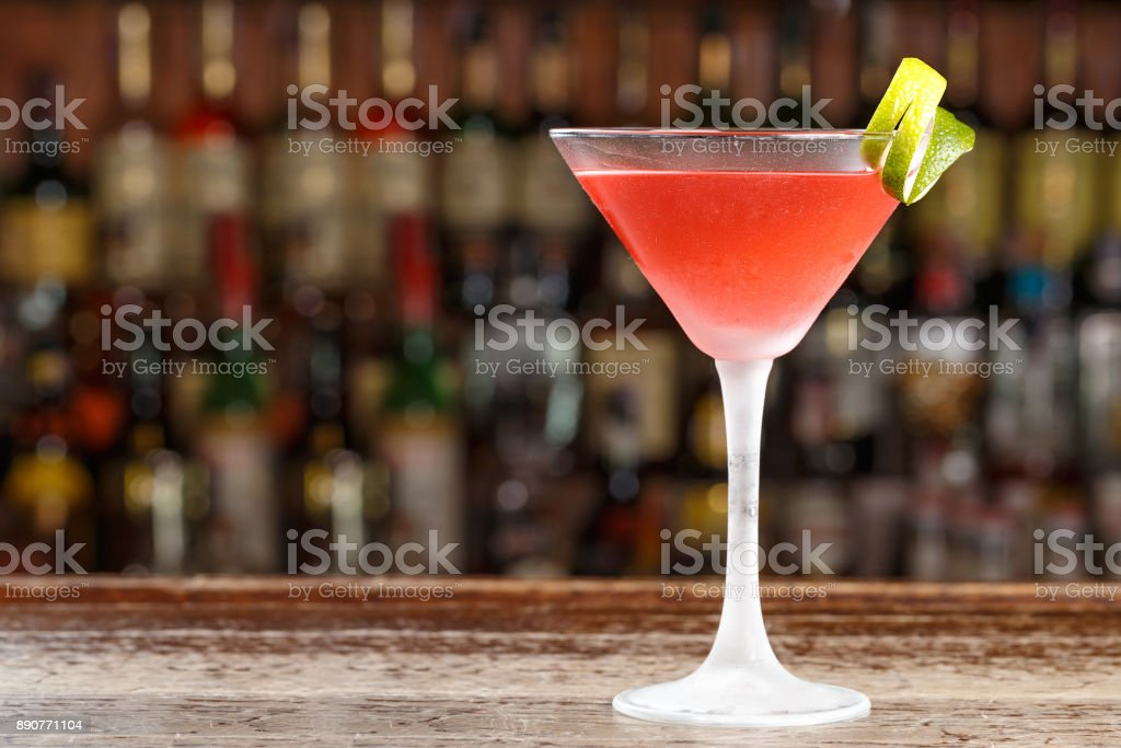 An alcoholic cosmopolitan cocktail is on the bar. Space for text. stock photo