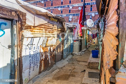 An Alley in the slum with the metal shacks of Alexandra Township, Johannesburg. Alexandra also known as Alex was developed since 1912 and allocated for the africans in the apartheid era, it is now home to over 400 000 inhabitants in an area 7,6 km2, and forms part of Johannesburg city council.
