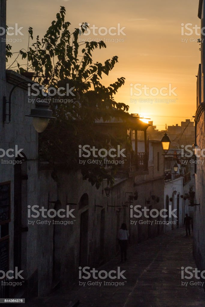 An alleyway in Arequipa city at dusk stock photo
