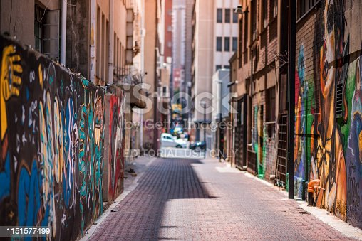 Johannesburg / South Africa - November 19 2016: An alleyway in Johannesburg inner city with graffiti on the walls