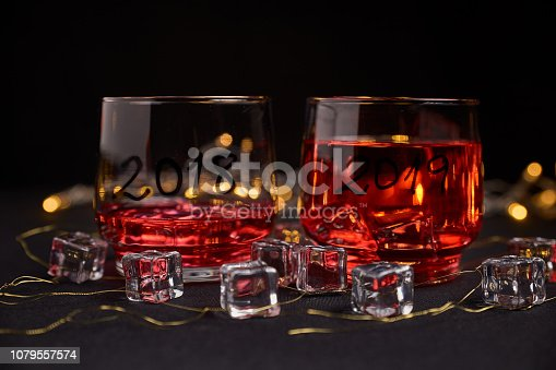 istock an almost empty glass of the year 2018 and another full of the new year 2019 1079557574