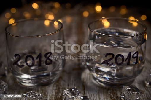 istock an almost empty glass of the year 2018 and another full of the new year 2019 1079557588
