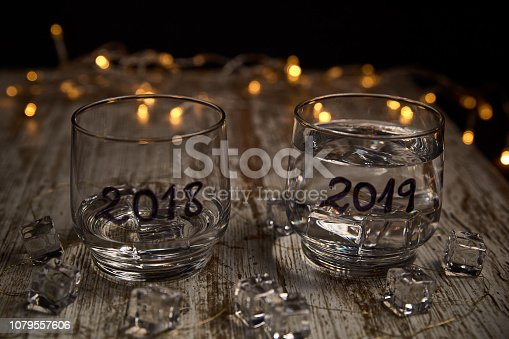 istock an almost empty glass of the year 2018 and another full of the new year 2019 1079557606