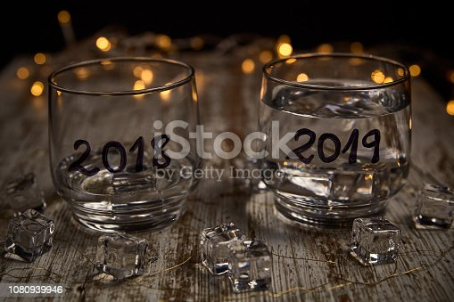 istock an almost empty glass of the year 2018 and another full of the new year 2019 1080939946