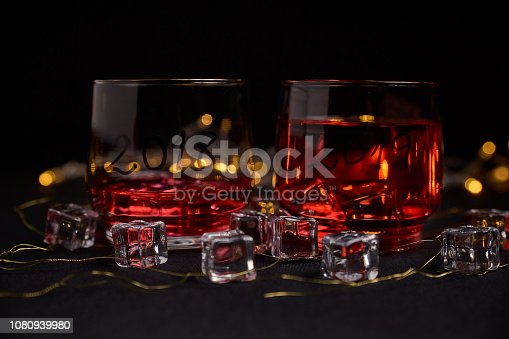 istock an almost empty glass of the year 2018 and another full of the new year 2019 1080939980