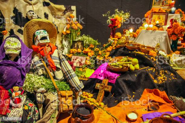 "An altar with an offering on the Day of the Dead in Yucatan in southern Mexico Merida, Mexico, november 01 - A traditional ""ofrenda"", an offering dedicated to the dead with numerous religious images and spiritual symbols during the celebrations of the Day of the Dead, in Merida, Yucatan, in south-eastern Mexico. Altar Stock Photo"
