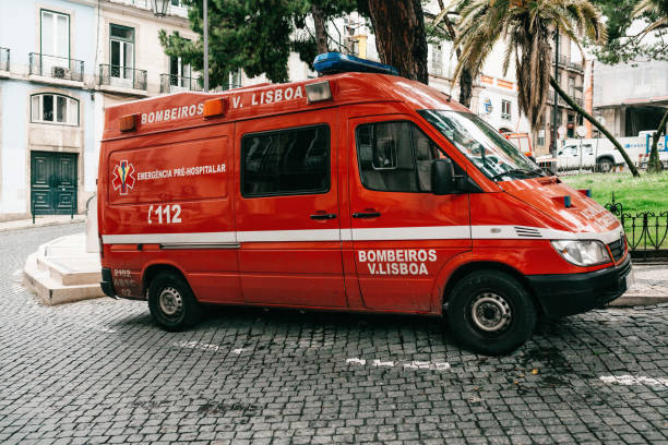 an ambulance is parked on a city street. salvation in emergency situations and health care. ambulance service 112. - resultados lisboa imagens e fotografias de stock
