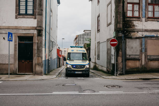 an ambulance rides on a call to the patient on a city street. salvation in emergency situations and health care. - resultados lisboa imagens e fotografias de stock