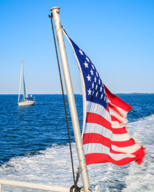 An American Flag Behind a Boat stock photo