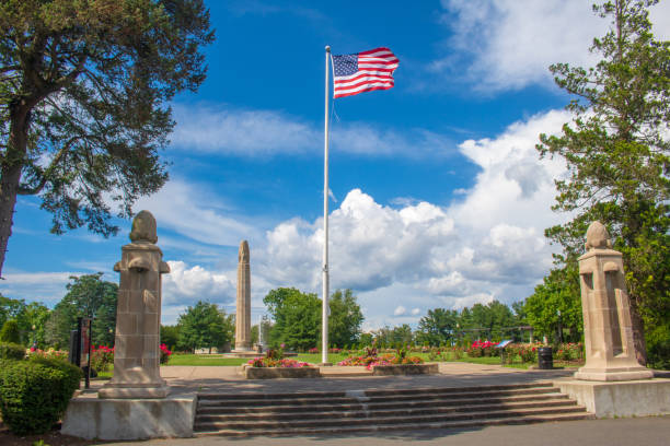 An American flag flies at the entrance to the Walnut Hill Park rose garden in New Britain, Connecticut stock photo