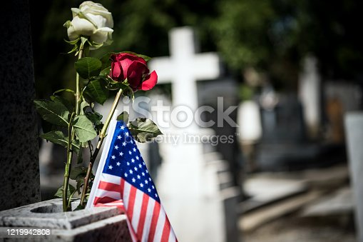 istock An American flag is seen on the grave of a veteran. 1219942808