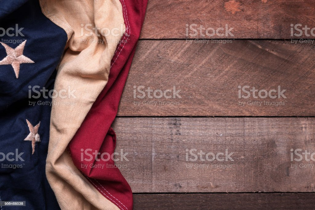 An American flag or bunting on a wooden background stock photo