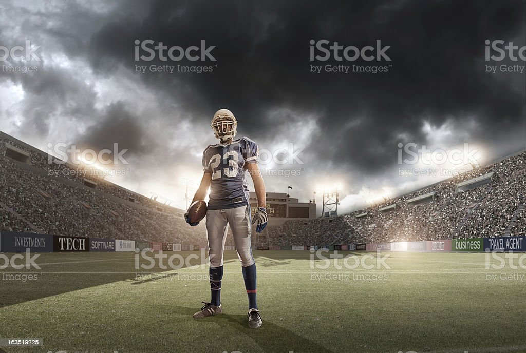An American football player on the field during a storm royalty-free stock photo