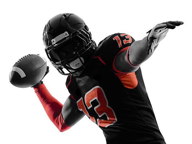 An American football player throwing the football one american football player quarterback passing portrait in silhouette shadow on white background quarterback stock pictures, royalty-free photos & images