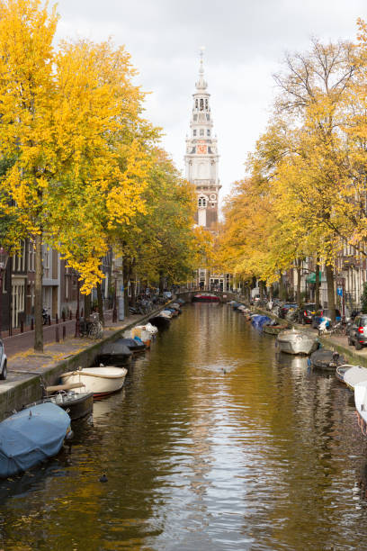 An Amsterdam canal with a Church in the end. stock photo