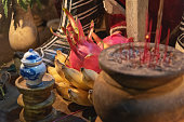 An arrangement of candles, incense and food as an offering to a family's Vietnamese ancestors