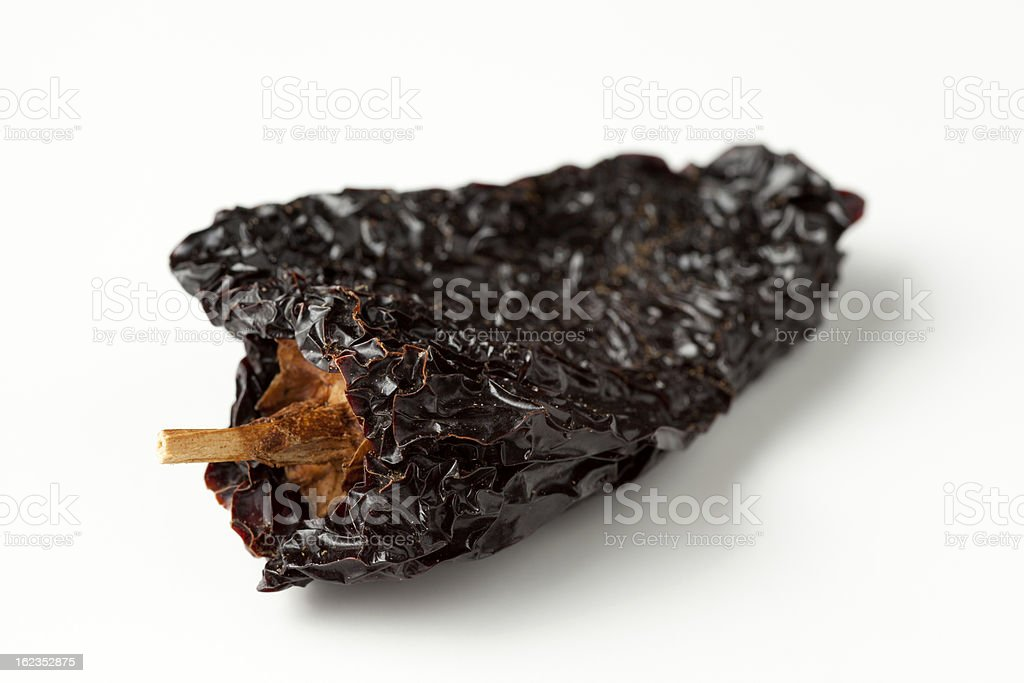 An ancho chili on a white background stock photo