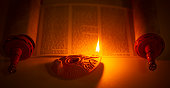 istock An Ancient Lamp Illuminating the Hebrew Text of the Torah 1284936096