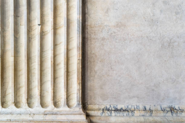 An ancient marble column with a portion of stone wall An ancient marble column with a portion of stone wall ancient rome stock pictures, royalty-free photos & images