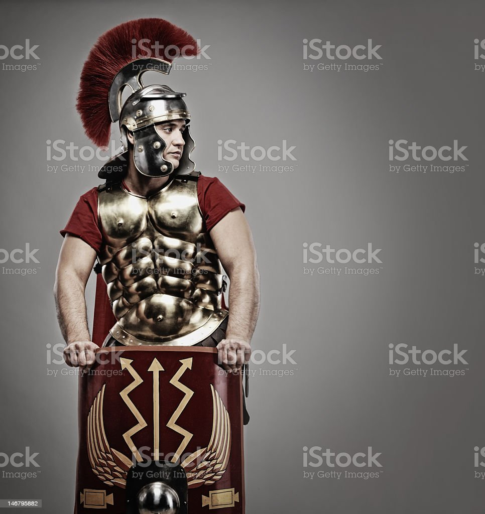 An ancient Roman soldier on a gray background stock photo