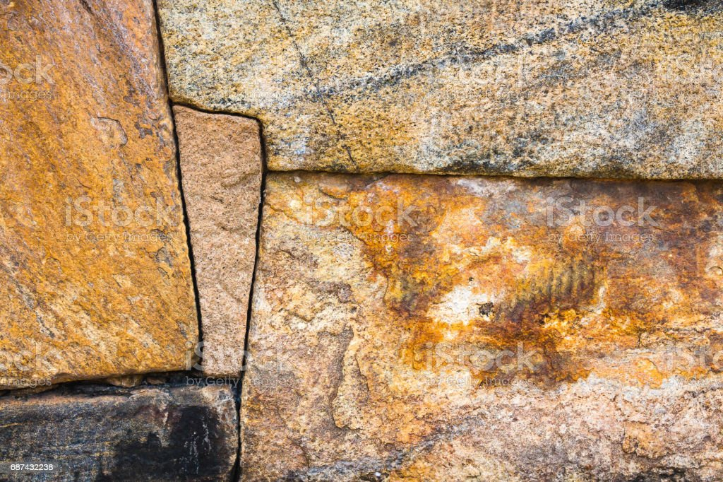 An ancient stone wall construction with perfectly interlocking stones in the ancient city of Polonnaruwa, Sri Lanka, a UNESCO world heritage site. stock photo