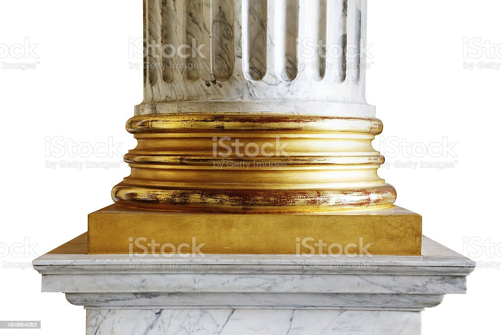 An ancient white marble classical column with gold incrustations stock photo