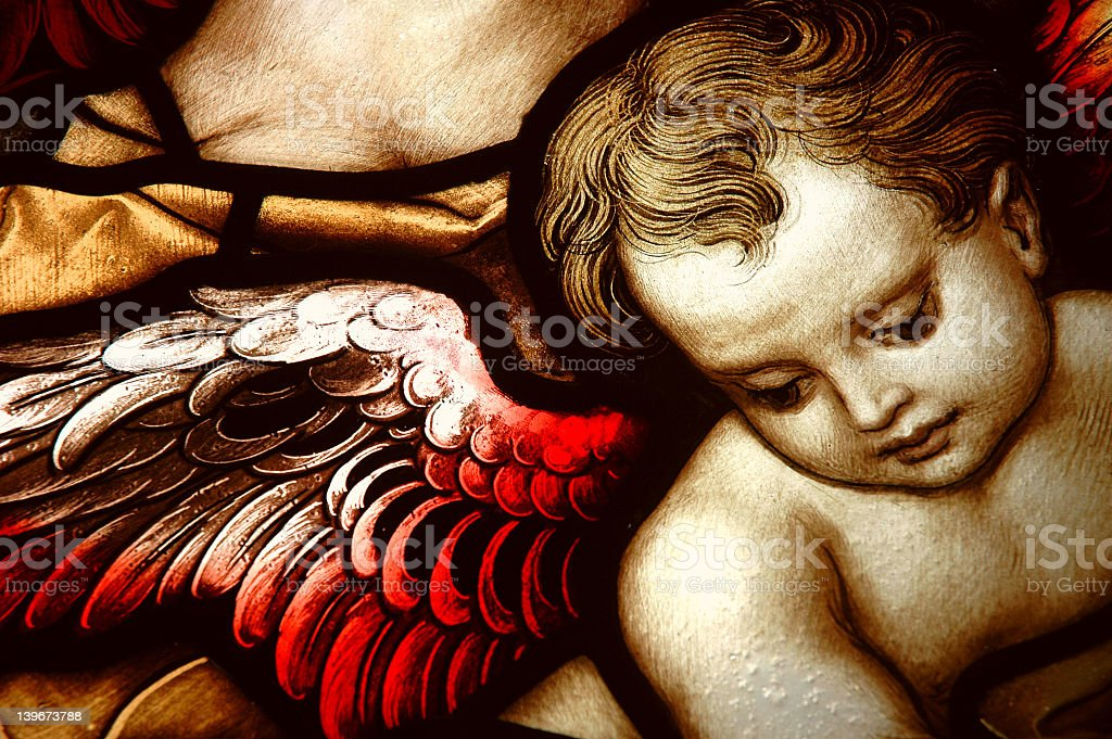 An angel on a stained glass window stock photo
