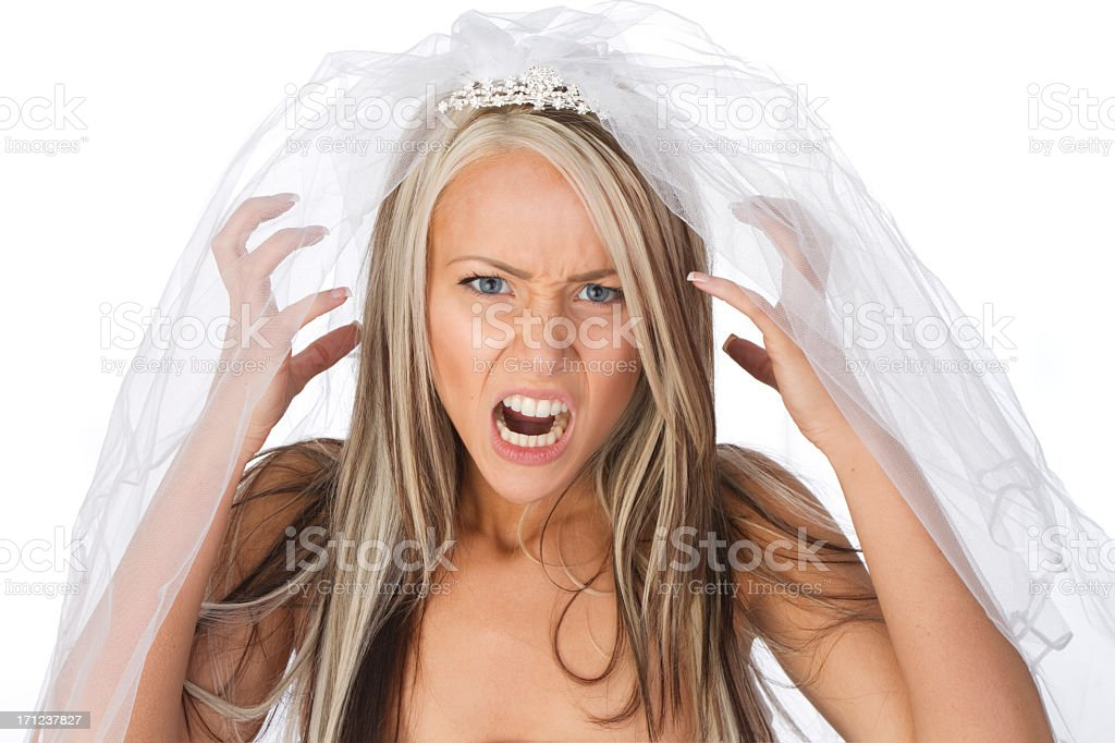 An angry woman wearing a veil, depicting a brides ills stock photo