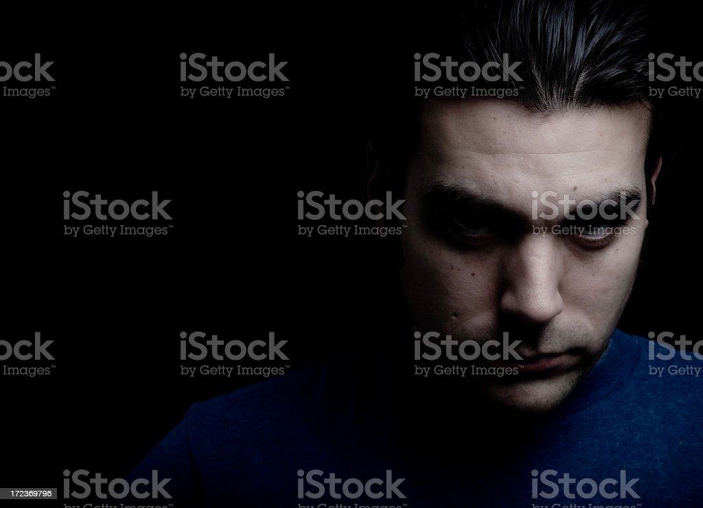 An angsty portrait of a man with dark thoughts stock photo
