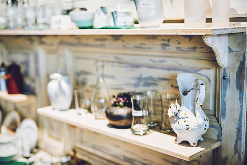 Shot of various ceramic and glass goods on a shelf in a vintage store