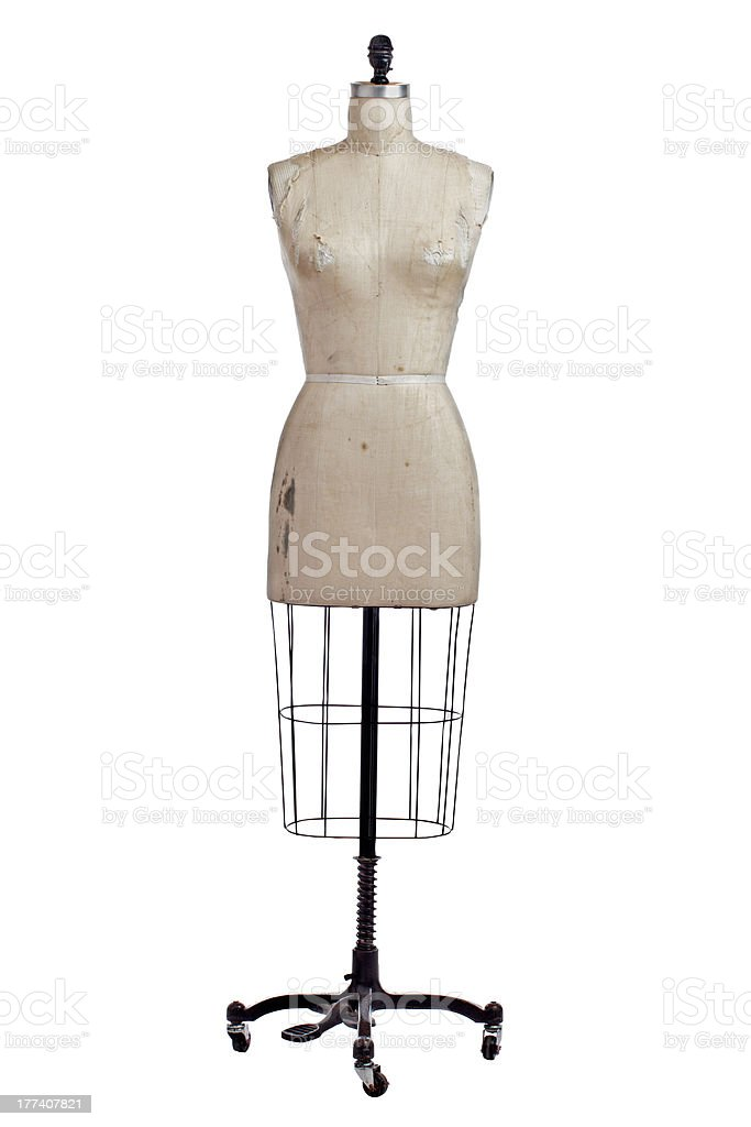 An antique mannequin used for making clothing stock photo