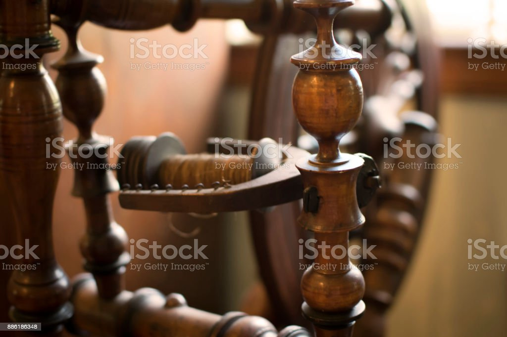 An Antique Spinning Wheel 18th Century stock photo