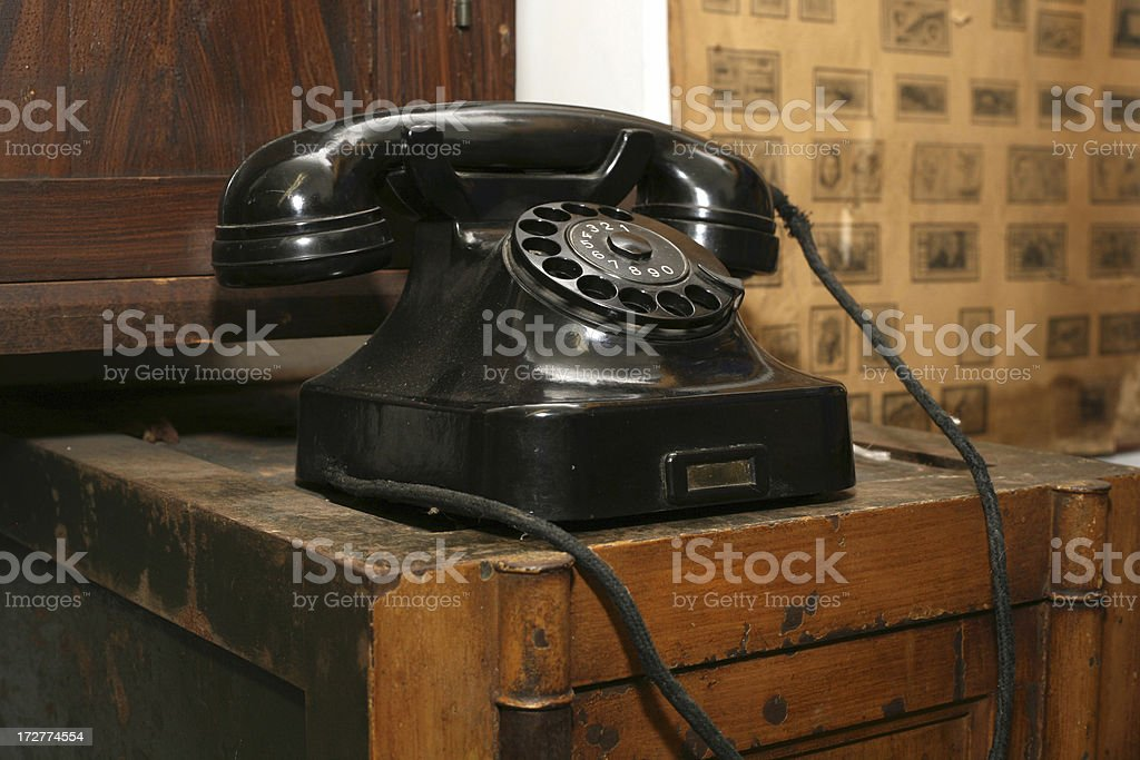 An antique telephone on a wooden table stock photo