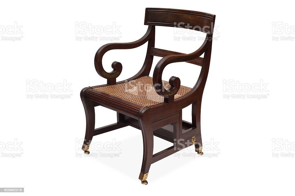 An Antique Wooden Armchair with Rattan Wicker Seat stock photo