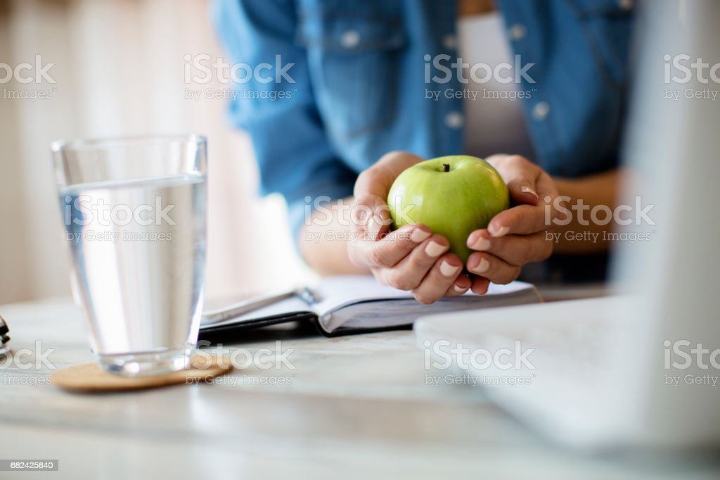 An apple and a glass of water royalty-free stock photo