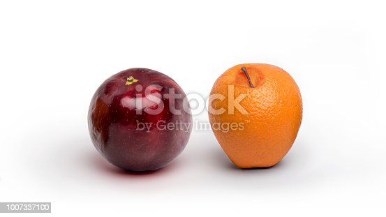 istock An apple and an orange having switched resemblance isolated on a white background 1007337100