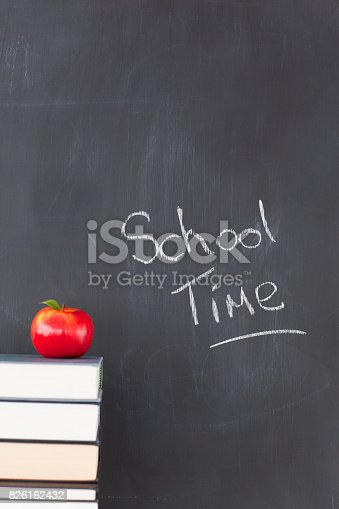 istock An apple some books and a blackboard 826162432