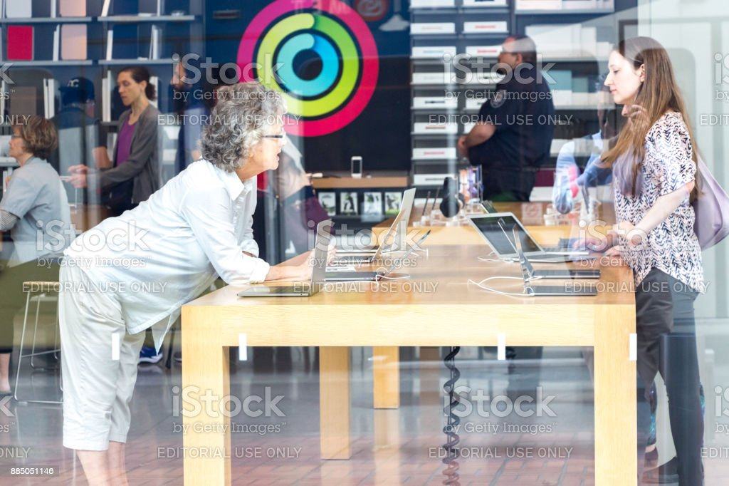 An Apple Store through the showcase. stock photo
