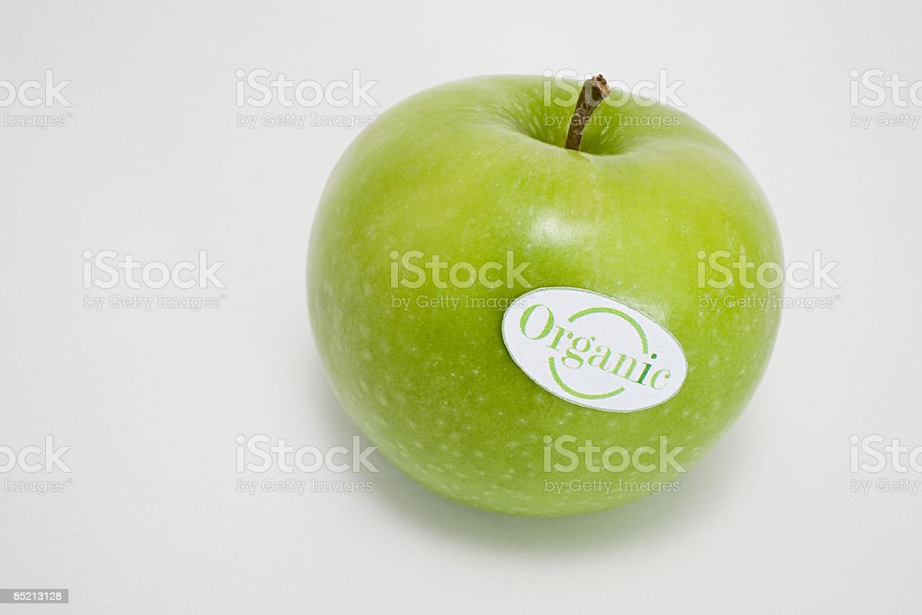 An apple with an organic label on it royalty-free stock photo