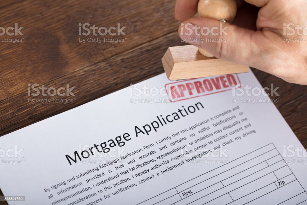 An Approved Stamp On Mortgage Application Form stock photo