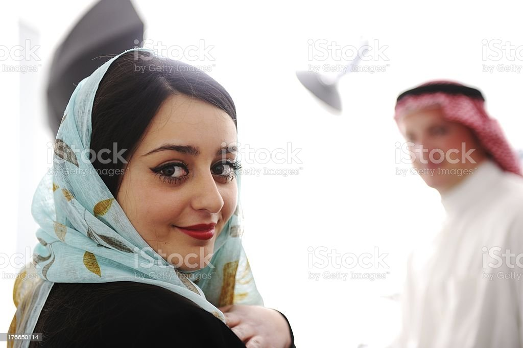 An Arabic couple with the woman smiling at the camera royalty-free stock photo