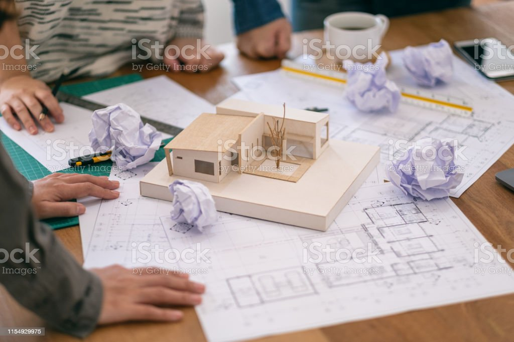 Group of an architect feel stressed after working on architecture...