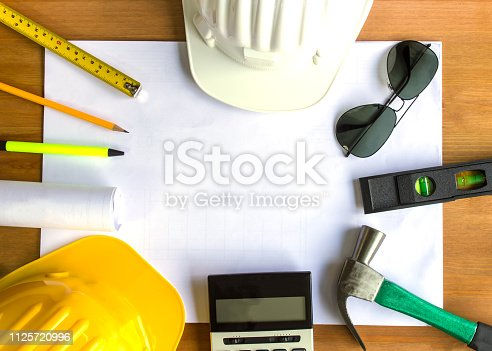 898133862 istock photo An architect working desk with tools and safety helmet with copy space 1125720996