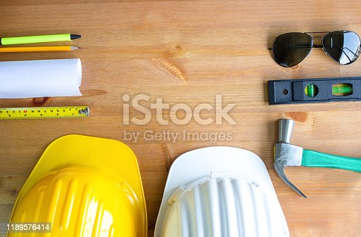 898133862 istock photo An architect working desk with tools and safety helmet with copy space,top view 1189576414